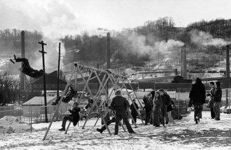 West Virginia students take recess while a factory emits steam and gases nearby. Photograph by James P. Blair, National Geographic