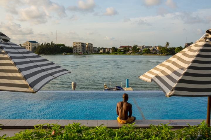 Victoria Island is popular weekend hangout for middle-class Lagosians and foreigners. Photograph by Robin Hammond, National Geographic