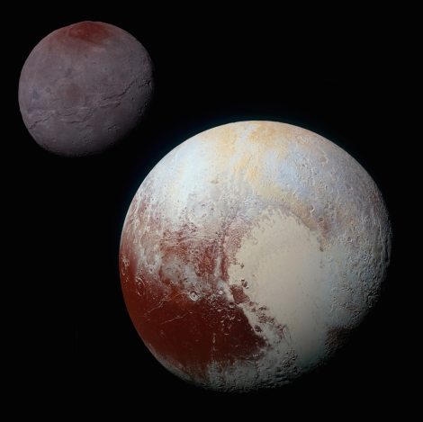 This composite of enhanced color images of Pluto and its big moon Charon were taken by NASA's New Horizons spacecraft on July 14, 2015. Photograph by NASA/JHUAPL/SwRI