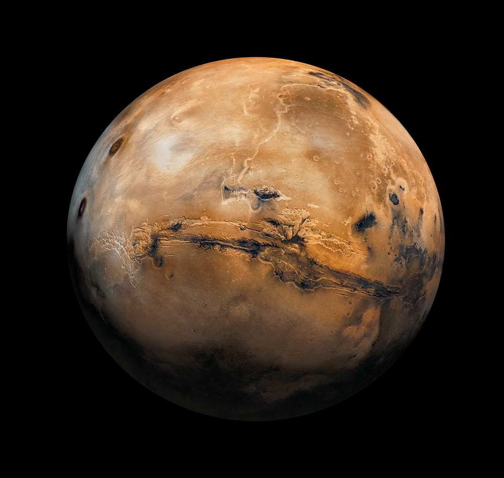 This composite image of Mars was captured by India's Mars Orbiter Mission  probe. Photograph by USGS, NASA, National Geographic.