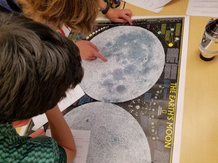 Students with moon map