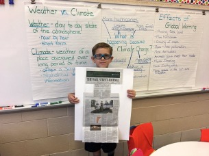 An American second-grader used the Wall Street Journal for research in the Climate Action project. Photograph courtesy Koen Timmers