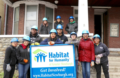 Students volunteering with Habitat for Humanity.png